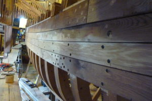 Third strake below the sheer plank took about 260 man-hours. Port side looking forward.